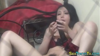 Japanese babe rides dildo