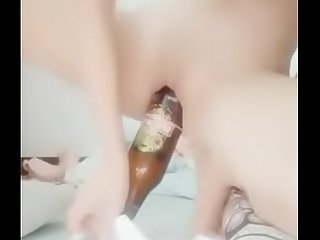 Kinky girl inserts bottle, can and banana into her pussy and ass then piss and poop in front of the cam.