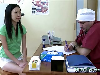 Nasty doctor fucks Asian patient in the ass