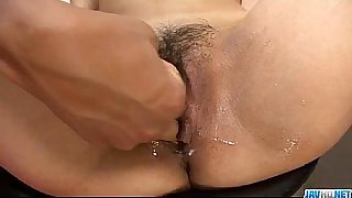 Reina Sakai uses dildo over her puffy Asian cunt